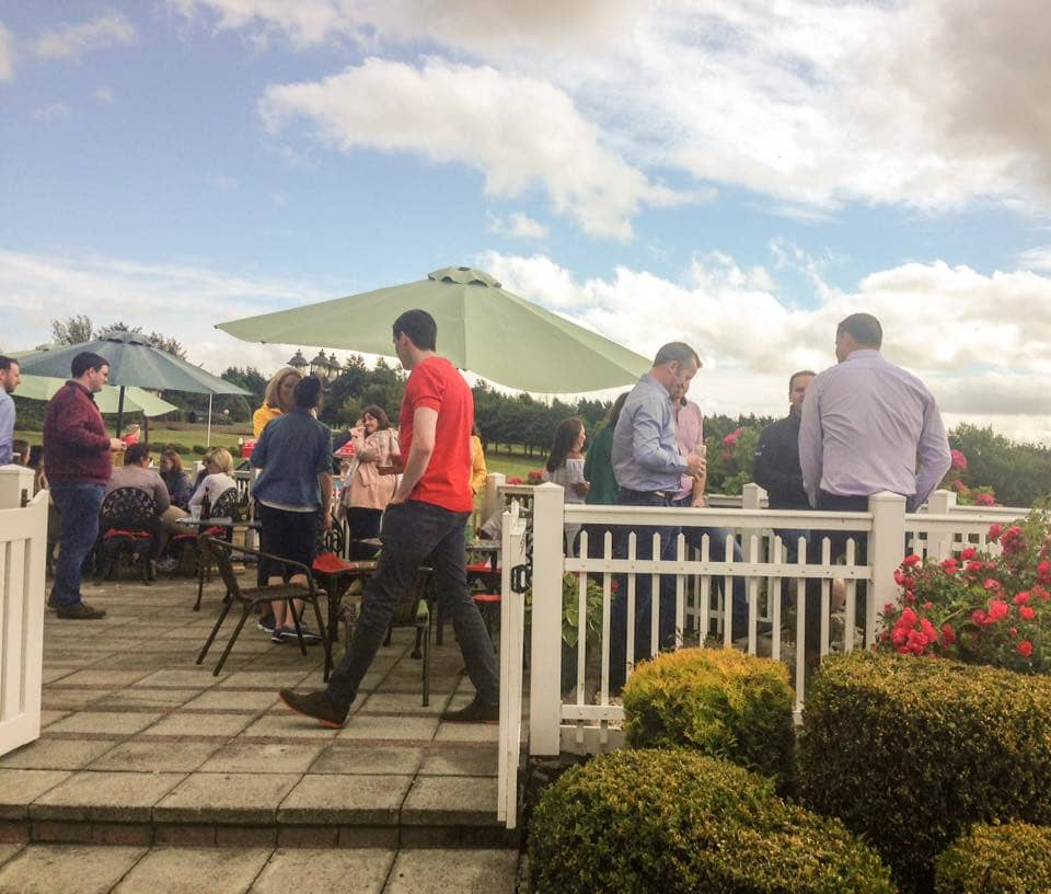 People enjoying a sunny day on the patio at Lee Valley near Cork